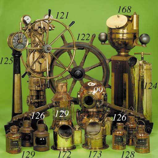 A pair of ornamental brass sig