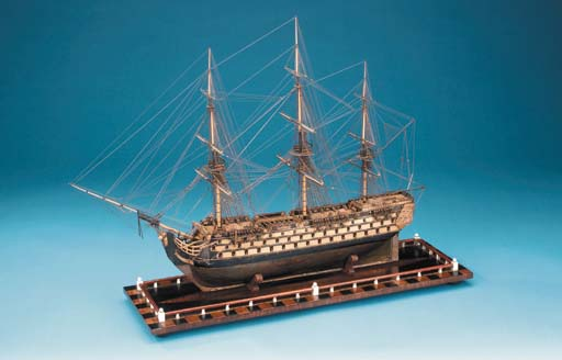 A finely carved fully rigged d