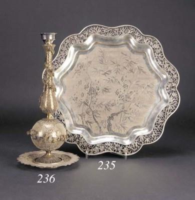 A silver filigree candleholder