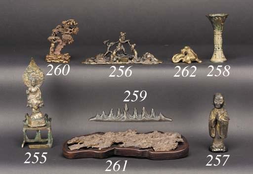 A bronze brushrest modelled as