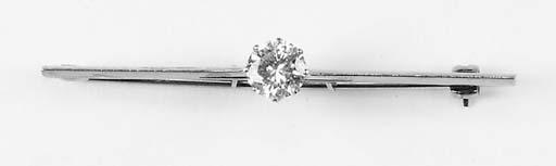 A diamond single stone bar brooch,