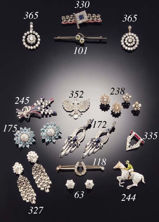 A diamond two stone bar brooch,