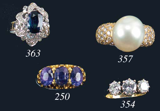 A sapphire three stone ring,