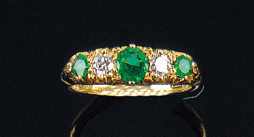 An emerald and diamond five st