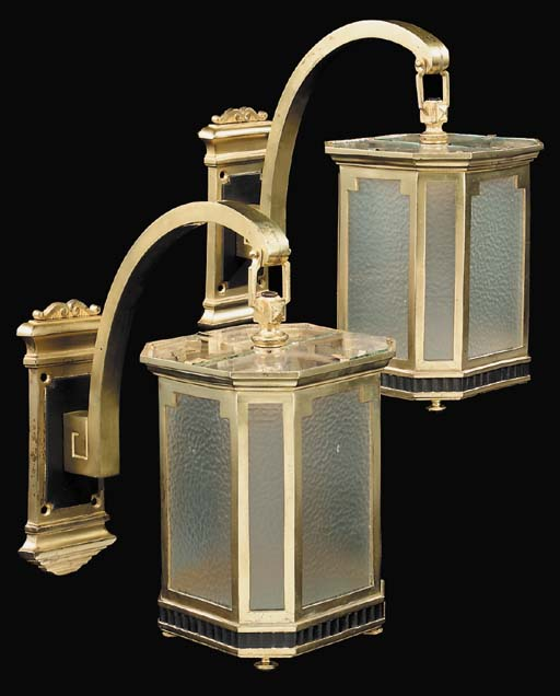 A pair of English gilt brass wall lanterns, first half 20th century
