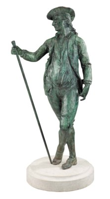 A bronzed metal figure of a ge