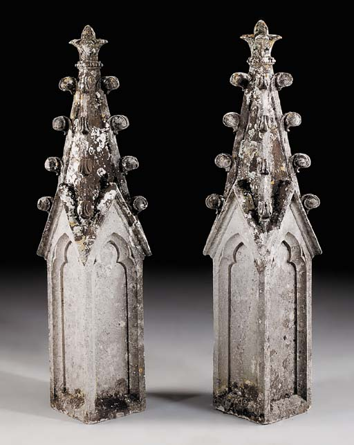 A pair of English carved stone spire finials, 19th century