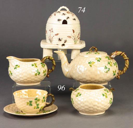 A Belleek honey pot and cover
