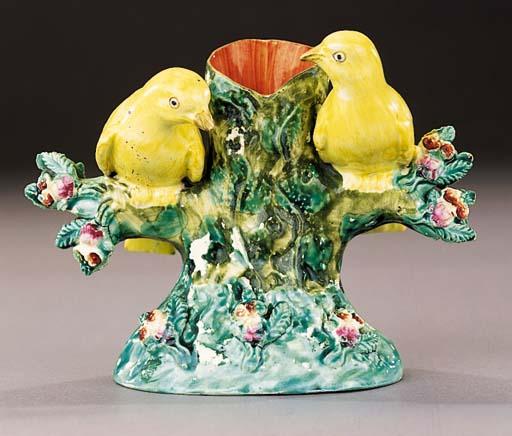 A creamware bird group spill vase
