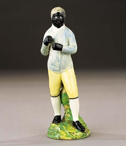 A pearlware figure of a negro pugilist