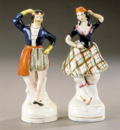 A pair of theatrical figures o