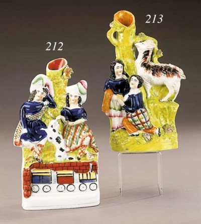 A spill vase group of two chil
