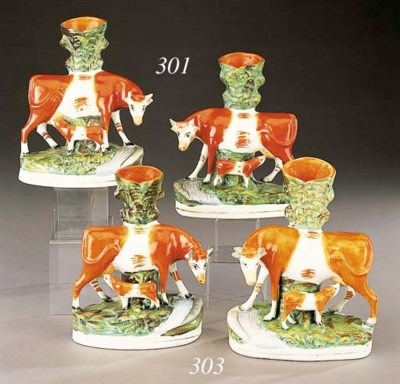 Two cow and calf spill vases