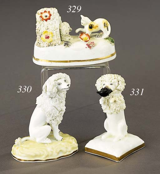 A porcelain model of a seated poddle