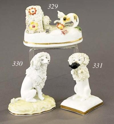 A porcelain model of a begging