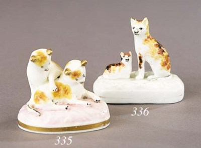 A porcelain group of a cat and