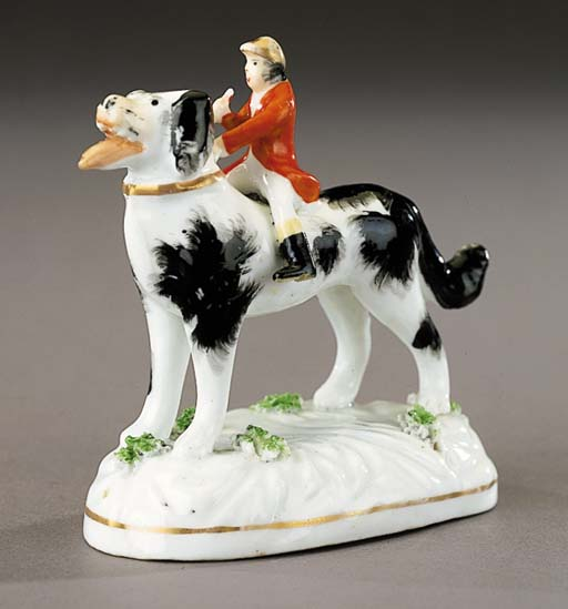 A porcelain group of a fox-hunter riding a hound