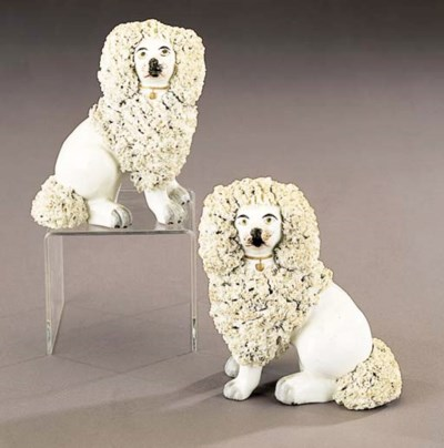 A pair of models of poodles