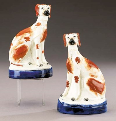 A pair of models of greyhounds