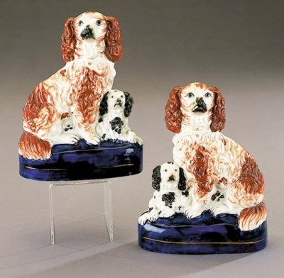 A pair of groups of spaniels a