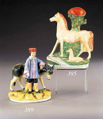A spill vase group of a horse