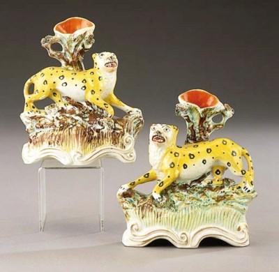 Two leopard spill vases