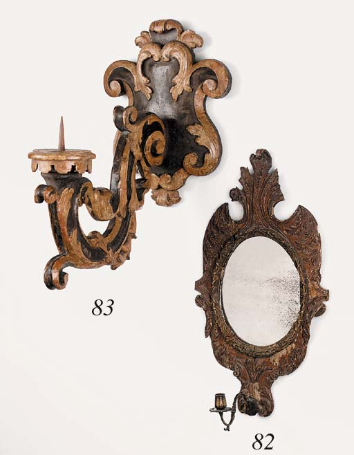An Italian carved wood and bra