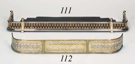 A George III brass fender, las