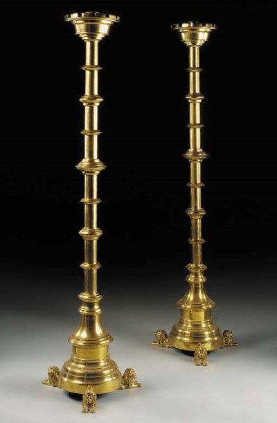 A pair of large brass floor st