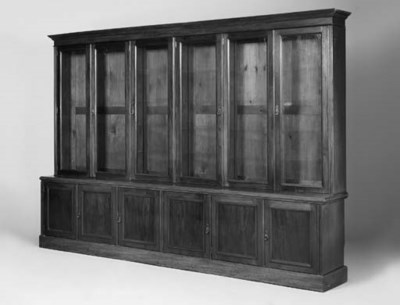 A large mahogany bookcase, ear