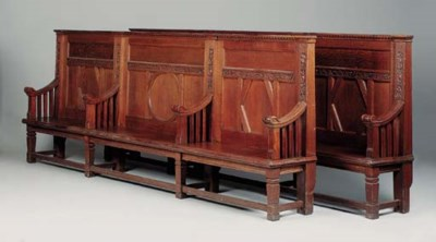 A late Victorian carved oak be