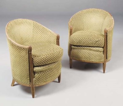 A pair of upholstered and gild