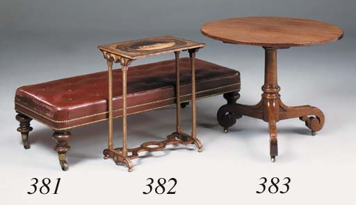 A mahogany and leather-upholst