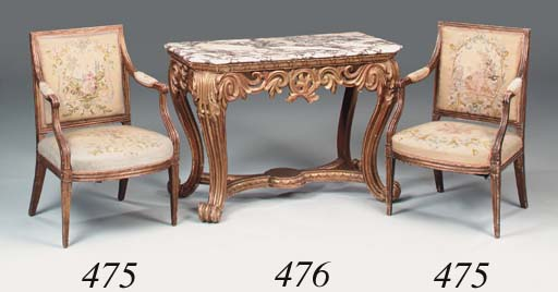 A carved giltwood and marble t