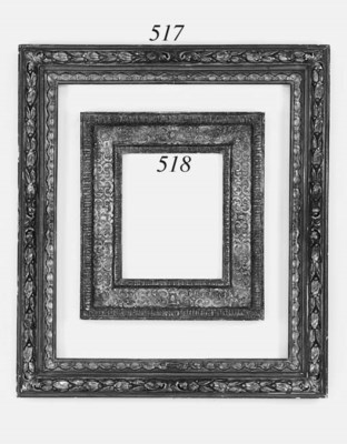 A carved and composition frame