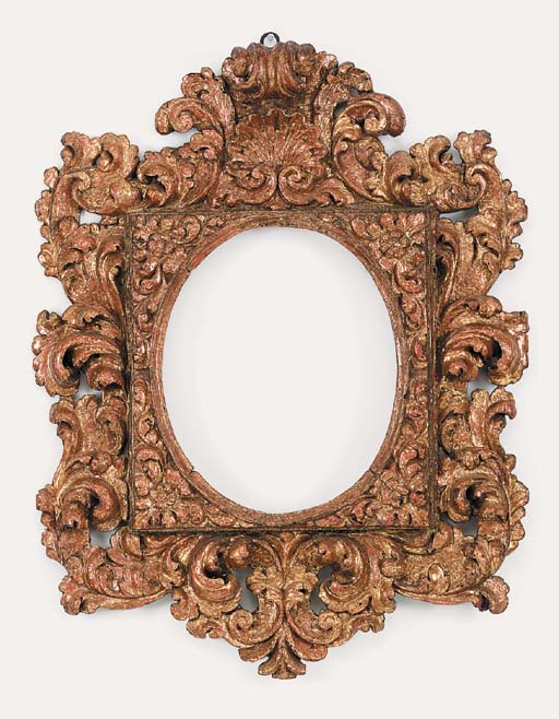 A Spanish carved and gilded oval frame, 17th century