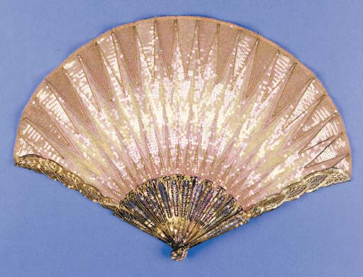 Eventail Point de Hongrie, by Duvelleroy, the leaf embroidered overall in pink sequins, inscribed Duvelleroy Paris on verso, the smokey grey mother of pear sticks carved and pierced to resemble feathers - 10.5in. (27cm.), circa 1908