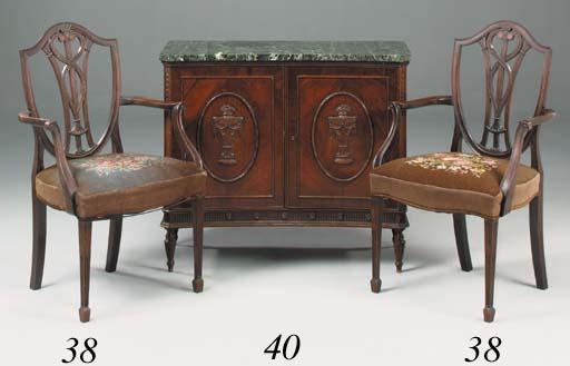 A pair of mahogany open armcha