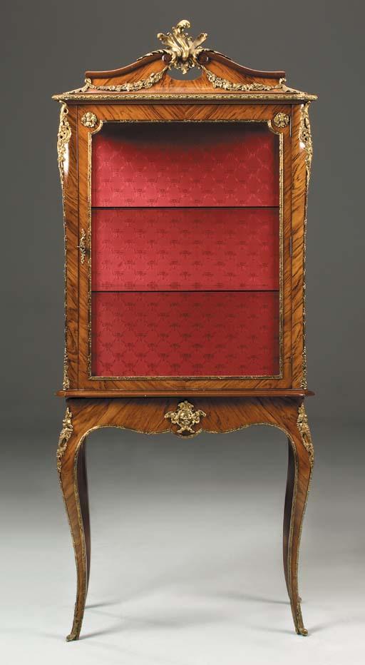 A kingwood and mahogany, gilt-