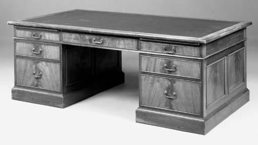 A large mahogany partners desk