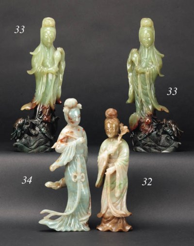 A pair of Chinese jade figures