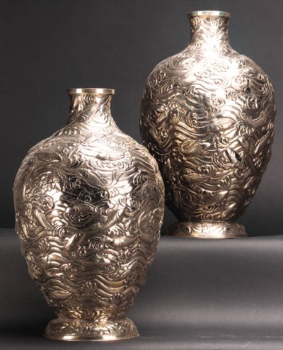 A pair of silver vases 20th ce