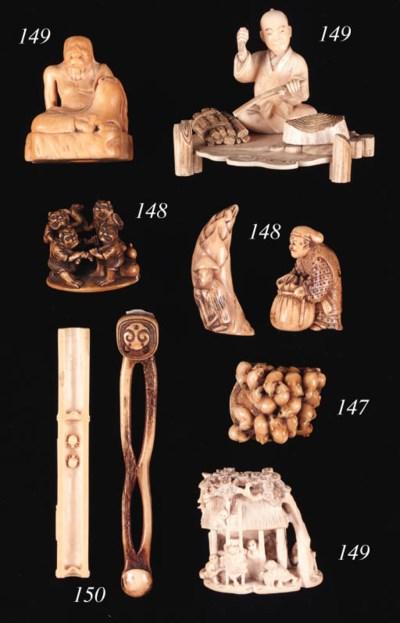 An ivory okimono of a woodcutt