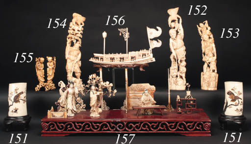 An ivory okimono of an Immortal and two oni 19th Century