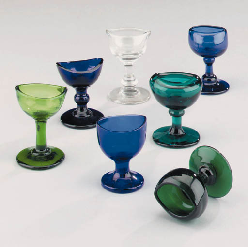 A collection of seven 19th-Century glass eye baths,
