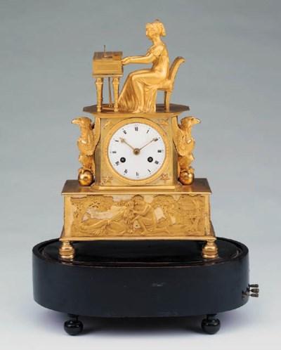 An Empire ormolu mantel clock