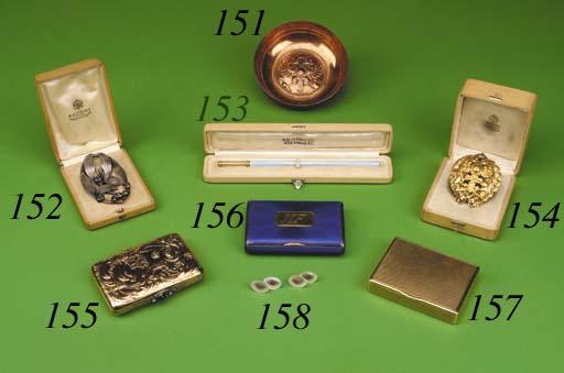 A gold Cigarette-case