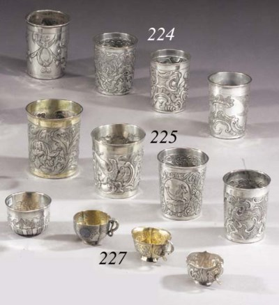 Four silver Beakers