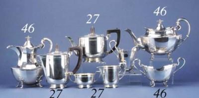 A FOUR-PIECE MODERN TEA AND CO