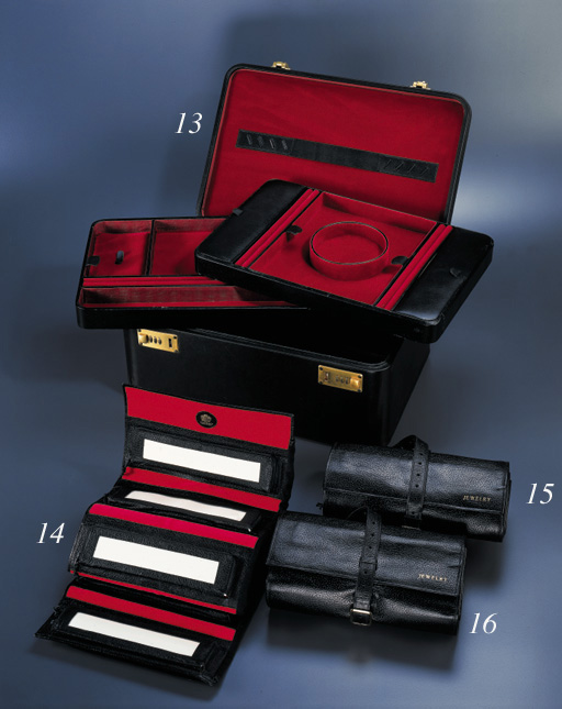 A LEATHER JEWELLERY CASE, BY M